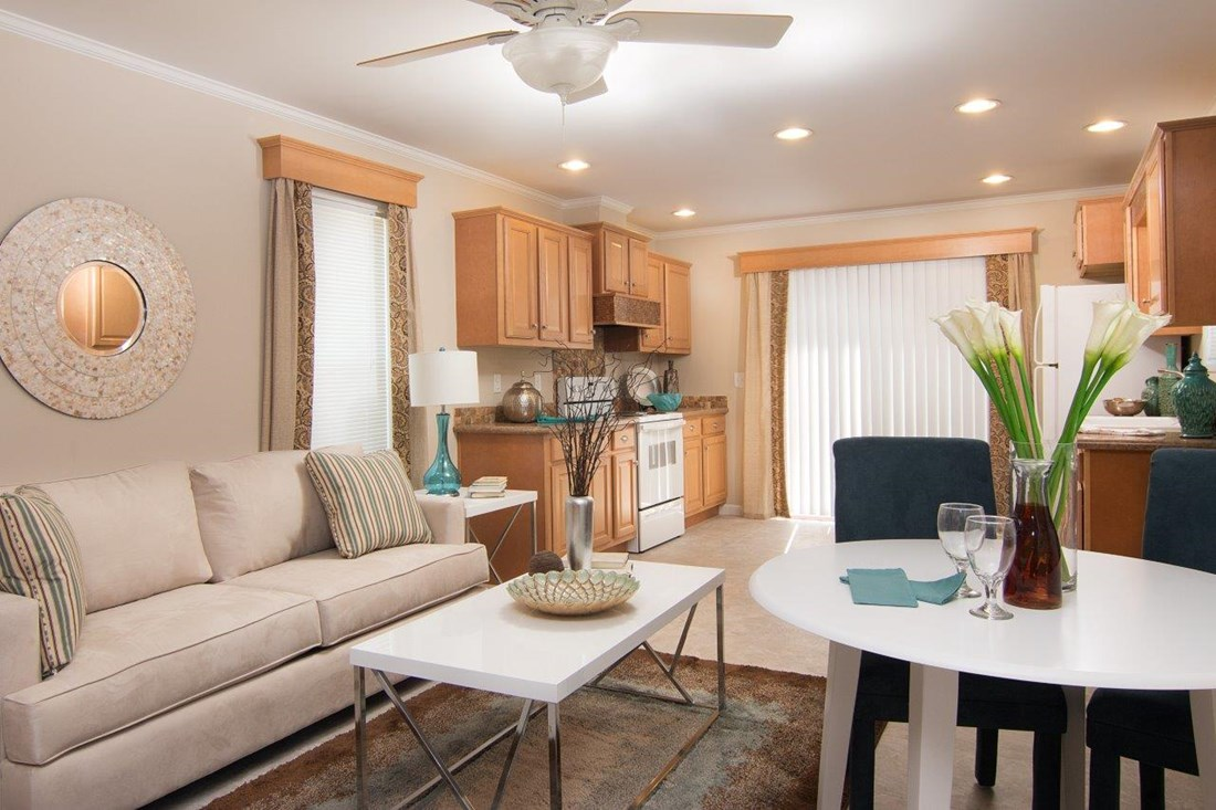 The LECCE 6014-1632 Living Room. This Manufactured Mobile Home features 2 bedrooms and 1 bath.